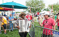 Nathan and the Zydeco Cha-Chas perform at the 2014 Jazz and Heritage Festival in New Orleans, LA.