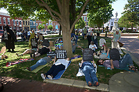 NWA Democrat-Gazette/BEN GOFF @NWABENGOFF<br /> Participants lay down with tombstone-shaped signs Sunday, May 7, 2017, during a 'Die-In for ACA' hosted by Ozark Indivisible on the Bentonville square. The group marched around the square and lay down in a 'die-in,' with many holding tombstone-shaped signs carrying personal messages about how healthcare costs and losing coverage for pre-existing conditions could lead to their premature death. The event comes after the U.S. House of Representatives approved legislation Thursday to largely repeal and replace the Affordable Care Act.