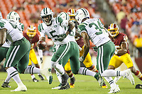 Landover, MD - August 16, 2018: New York Jets quarterback Teddy Bridgewater (5) hands the ball off to New York Jets cornerback Jeremy Clark (34) during the preseason game between New York Jets and Washington Redskins at FedEx Field in Landover, MD.   (Photo by Elliott Brown/Media Images International)
