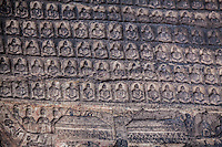 Miniature Buddhas carved on a wall at the Yungang Grottoes, Datong, China