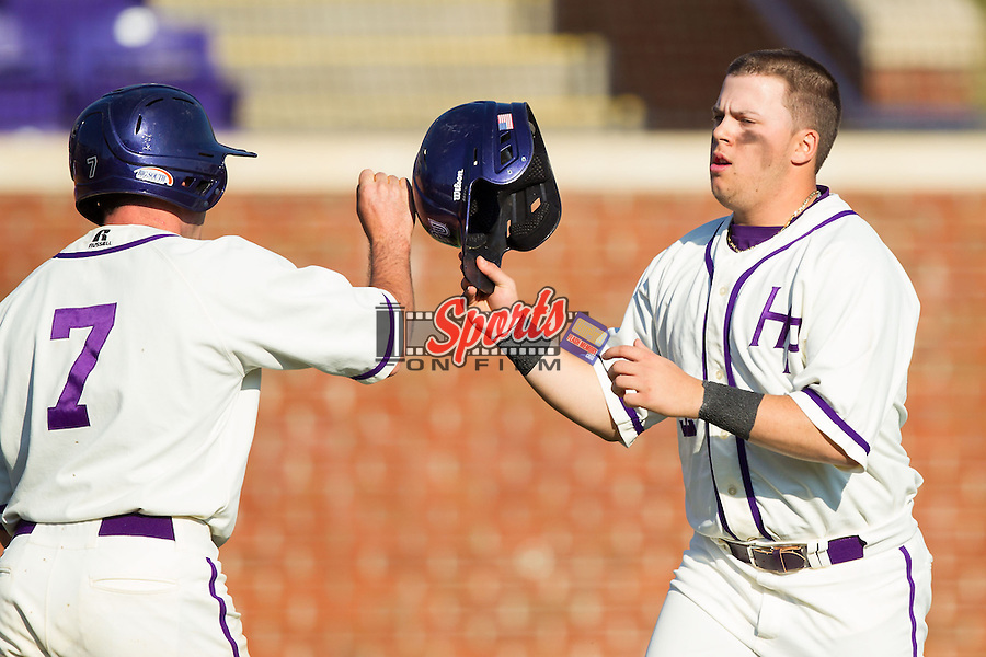 Dominic Fazio (32) of the High Point Panthers is congratulated by teammate Dane McDermott (7) after scoring a run against the Bowling Green Falcons at Willard Stadium on March 9, 2014 in High Point, North Carolina.  The Falcons defeated the Panthers 7-4.  (Brian Westerholt/Sports On Film)