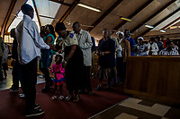 SOWETO, JOHANNESBURG, SOUTH AFRICA - DECEMBER 08: Parishioners sing during church services at Regina Mundi Catholic Church in Soweto on December 8, 2013 in Johannesburg, South Africa. Mr Mandela, died on Thursday aged 95, spent 27 years in jail before becoming South Africa's first black president in 1994.<br /> Photo by Daniel Berehulak for The New York Times
