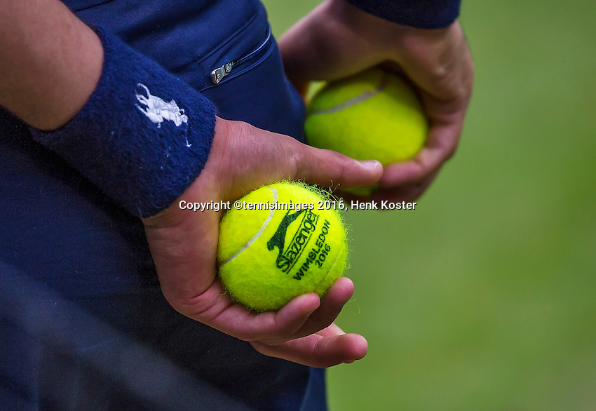 London, England, 01 July, 2016, Tennis, Wimbledon, Ballboy holds Wimbledon 2016 tennis ball<br /> Photo: Henk Koster/tennisimages.com