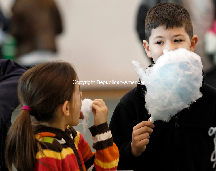 Middlebury, CT-08 January 2012-010812CM06-  Olivia, 7, and Andrew, 8, White of Middlebury enjoy cotton candy during the Dorcas Festival inside the Fuller Athletic Center at Westover School in Middlebury Sunday afternoon.  The annual event, run by the juniors at the school, raises money for local and international charities.  The event featured food, indoor rock climbing, a silent auction, games and bouncy houses.  Christopher Massa Republican-American