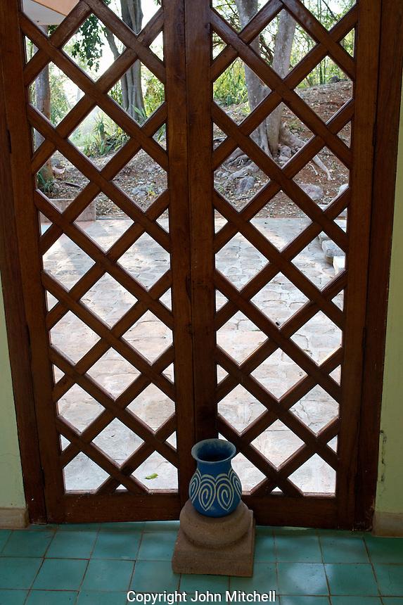 Vase and wooden lattice decoration, Hotel Hacienda Uxmal near the Mayan ruins of Uxmal, Yucatan, Mexico.