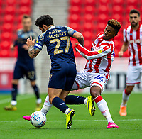 4th July 2020; Bet365 Stadium, Stoke, Staffordshire, England; English Championship Football, Stoke City versus Barnsley; Tyrese Campbell of Stoke City tackles Alex Mowatt of Barnsley