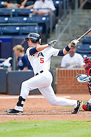 Matt Reynolds #5 (Arkansas) of the USA Baseball Collegiate National Team follows through on his swing against the Japan Collegiate National Team at the Durham Bulls Athletic Park on July 3, 2011 in Durham, North Carolina.  USA defeated Japan 7-6.  (Brian Westerholt / Four Seam Images)