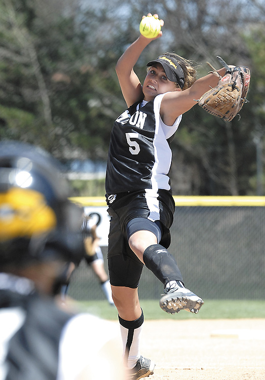 Sentinel/Dan Irving.Hamilton senior Lindsey Brouwer winds up for a pitch against West Ottawa Saturday afternoon at West Ottawa High School..(4/15/06)
