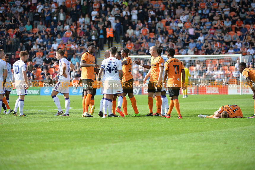 David Tutonda of Barnet goes down under challenge from Glen Rea of Luton Town during Barnet vs Luton Town, Sky Bet EFL League 2 Football at the Hive Stadium on 12th August 2017