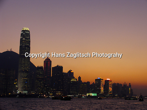 Skyline of Hongkongs Central District with the International Finance Centre at sunset.