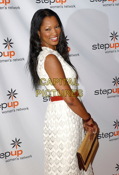 GARCELLE BEAUVAIS-NILON.Attends The Step Up Women's Network Inspiration Awards Luncheon held at The Beverly Hilton in Beverly Hills, California, USA, April 22nd 2005..half length white cream long lace crochet dress beauvais nilon touching bangles wooden brown bracelets chunky woven beige clutch bag .Ref: DVS.www.capitalpictures.com.sales@capitalpictures.com.©Debbie VanStory/Capital Pictures