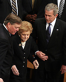 Jack Ford, left, helps his mother, former first lady Betty Ford, to her seat as United States President George W. Bush looks on during the State Funeral for former United States President Gerald R. Ford at the Washington National Cathedral, in Washington, D.C. on Tuesday, January 2, 2007..Credit: Ron Sachs / CNP.[NOTE: No New York Metro or other Newspapers within a 75 mile radius of New York City].