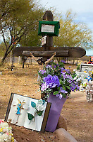 Jesus on the cross at a grave at the old Mexican cemetery in Tubac Arizona.