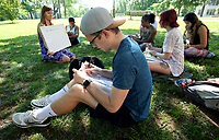 NWA Democrat-Gazette/DAVID GOTTSCHALK  Charles Hartman, a sophomore at the University of Arkansas, studies Monday, May 8, 2017, with classmates and instructor Ginny Ogle (left) for a final in French Intermediate II on the lawn on the campus in Fayetteville. The Spring All-University Commencement Ceremony is Saturday and will begin  at 8:30 a.m. in Bud Walton Arena with a pre-ceremony concert featuring the University Wind Symphony beginning at 8:00 a.m. Doors open at 7:15 a.m.