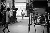A rickshaw puller waits for customer  in Calcutta, India. 93 out of every 100 rickshaw pullers are homeless. They sleep after the city sleeps and wake up before everyone else does. Many of them are the sole bread earners for their family. Many plus 40. Many minus any other specialisation for any other job. Of the twenty four thousand rickshaw pullers, only 387 have licenses. .Many rickshaw pullers earn a meagre wage of 100-150 rupees (US $ 2.25-3.5) a day of which they have to give a daily rickshaw rent of 60 (US$ 1.35) rupees to the agent at the end of the day.