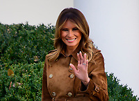 First lady Melania Trump waves to the crowd after she and United States President Donald J. Trump presented the National Thanksgiving Turkey in the Rose Garden of the White House in Washington, DC on Tuesday, November 26, 2019.<br /> CAP/MPI/RS<br /> ©RS/MPI/Capital Pictures