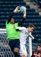 Nick Besler (8) of Notre Dame challenges Zack Steffen (99) of Maryland  during the NCAA Men's College Cup final at PPL Park in Chester, PA.  Notre Dame defeated Maryland, 2-1.
