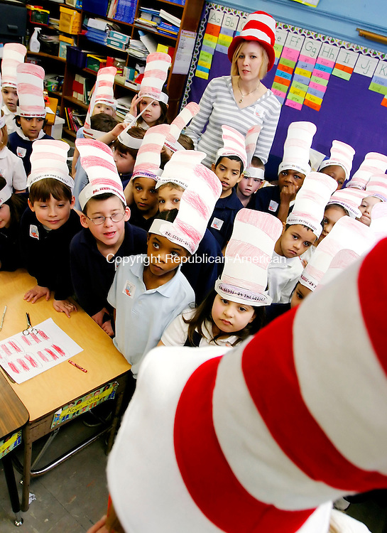 WATERBURY, CT. 02 March 2007--030207SV04--First grade teacher Maura Bemer stands with the first grade at Tinker School while they read Cat in the Hat during National Read Across America and Dr Seuss's 103rd birthday.<br /> Steven Valenti Republican-American