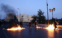 Pictured: Firebombs explode near riot police in front of the Greek Parliament Sunday 09 May 2016<br /> Re: Riots break out between protesters and police in Syntagma Square, while MPs in the Greek Parliament vote for new tax, pension and welfare reforms in Athens, Greece