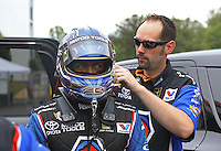 May 11, 2013; Commerce, GA, USA: NHRA crew member for top fuel dragster driver Antron Brown during the Southern Nationals at Atlanta Dragway. Mandatory Credit: Mark J. Rebilas-