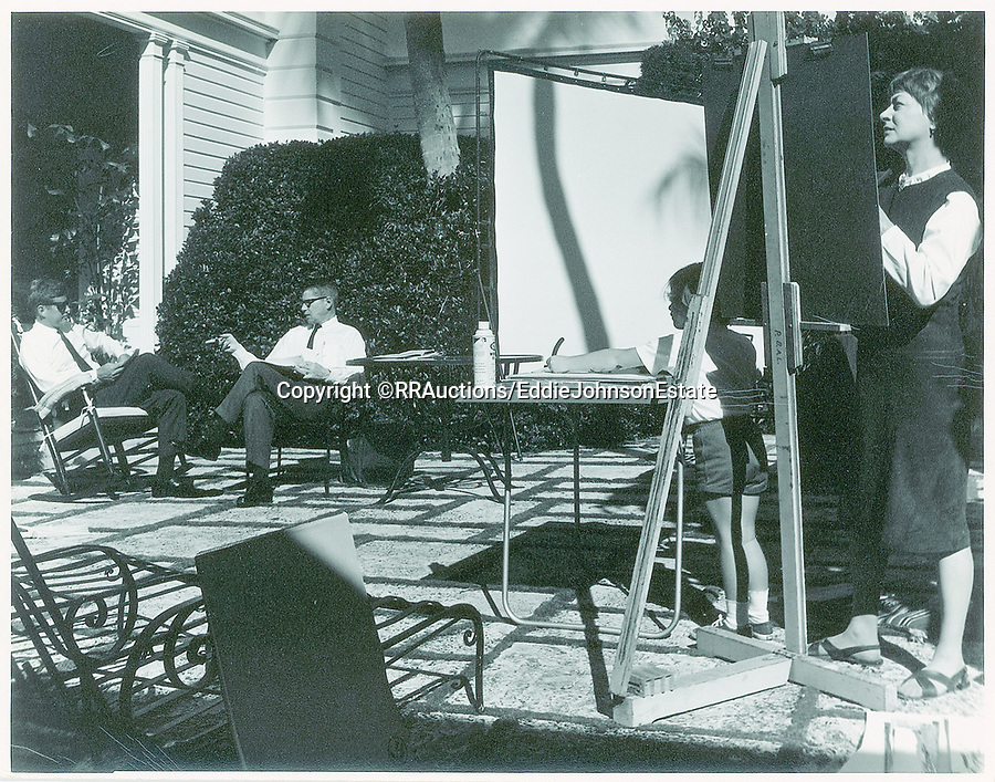 BNPS.co.uk (01202 558833)<br /> Pic: RR/EddieJohnsonEstate/BNPS<br /> <br /> This photo shows JFK's only suviving daughter Caroline at her own easel.<br /> <br /> Candid never before seen photos of President Kennedy on a 'working holiday' less than a year before he was assassinated have come to light.<br /> <br /> The fascinating snaps show John F Kennedy at work and relaxing at his idyllic Palm Beach residence, his 'Winter White House', in December 1962 and January 1963.<br /> <br /> He can be seen reading documents while sat on his patio, chatting with one of his advisers and taking a break from official business to soak up the sun in his garden.<br /> <br /> While this was going on, Kennedy was having his portrait drawn by celebrated artist of the age Elaine de Kooning.