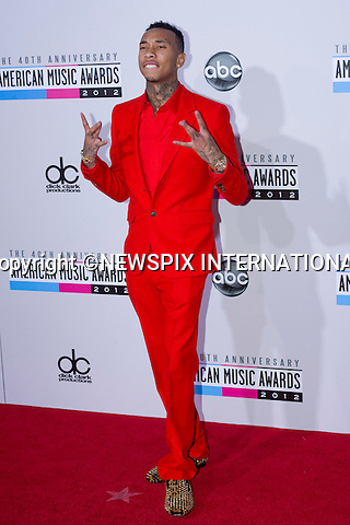 "TYGA.attends the 40th American Music Awards, Nokia Theatre, Los Angeles_18/11/2012.Mandatory Photo Credit: ©Dias/Newspix International..**ALL FEES PAYABLE TO: ""NEWSPIX INTERNATIONAL""**..PHOTO CREDIT MANDATORY!!: NEWSPIX INTERNATIONAL(Failure to credit will incur a surcharge of 100% of reproduction fees)..IMMEDIATE CONFIRMATION OF USAGE REQUIRED:.Newspix International, 31 Chinnery Hill, Bishop's Stortford, ENGLAND CM23 3PS.Tel:+441279 324672  ; Fax: +441279656877.Mobile:  0777568 1153.e-mail: info@newspixinternational.co.uk"