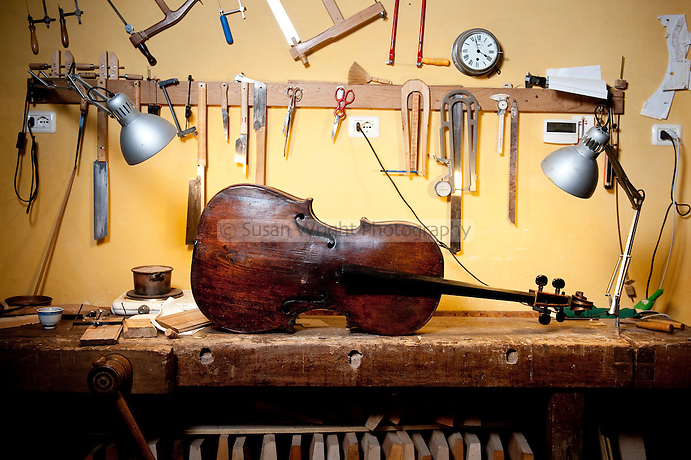 17th Century cello awaits attention in the workshop (bottega) of artisan violin maker and restorer, Aldo Santini, Via dei Velluti, Florence, Italy
