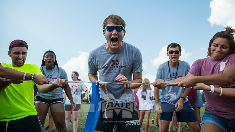 New Maroon campers and counselors enjoy Family Olympics on a hot summer day on the Club Sports Fields. New Maroon camp counselor Hayden Park monitors tug a war.<br />  (photo by Sarah Dutton / &copy; Mississippi State University)