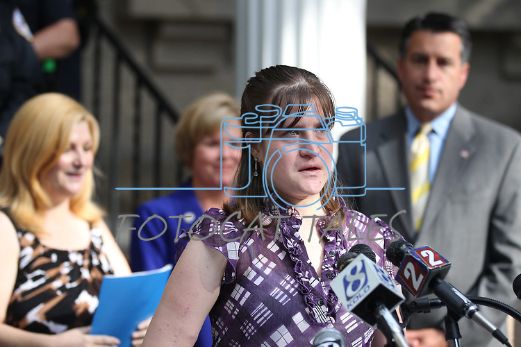 A tearful Jenifer Watkins speaks during a press conference at the Capitol in Carson City, Nev., on Thursday, Sept. 29, 2011, about nearly being killed by a distracted driver in 2004.  Nevada's new law banning the use of handheld devices by drivers goes into effect on Oct. 1.  Her mother-in-law Sandy Watkins, at left, the bill's sponsor Sen. Shirley Breeden, D-Henderson, center rear, and Gov. Brian Sandoval also spoke. .Photo by Cathleen Allison