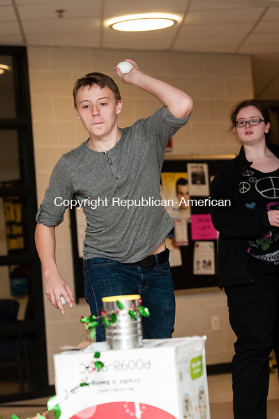 """WATERBURY, CT-1 December 2014-120114EC05-  Tom Dowie throws a snowball during play rehearsal Monday night at Kaynor Tech in  Waterbury. The school will be putting on """"A Charlie Brown Christmas,"""" along with a talent show this weekend. The performances are in conjunction with Kaynor Tech's holiday bazaar and craft show. The talent show begins at 7pm Friday, with another performance Saturday at noon, followed by the Charlie Brown play. Erin Covey Republican-American"""
