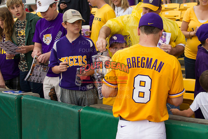 LSU Tigers shortstop Alex Bregman (8) signs autographs before the Southeastern Conference baseball game against the Texas A&M Aggies on April 25, 2015 at Alex Box Stadium in Baton Rouge, Louisiana. Texas A&M defeated LSU 6-2. (Andrew Woolley/Four Seam Images)