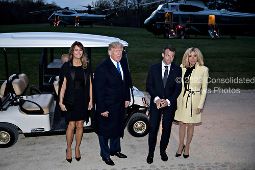 U.S. President Donald Trump, second left, speaks to members of the media next to a golf cart following a dinner with U.S. First Lady Melania Trump, from left, Emmanuel Macron, France's president, and Brigitte Macron, France's first lady, at the Mount Vernon estate of first U.S. President George Washington in Mount Vernon, Virginia, U.S., on Monday, April 23, 2018.  As Macron arrives for the first state visit of Trump's presidency, the U.S. leader is threatening to upend the global trading system with tariffs on China, maybe Europe too. <br /> Credit: Andrew Harrer / Pool via CNP<br /> Credit: Andrew Harrer / Pool via CNP