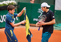 03-06-13, Tennis, France, Paris, Roland Garros,  Tommy Haas gets a towel from a ballboy