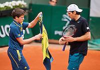 03-06-13, Tennis, France, Paris, Roland Garros,  Tommy Haas gets a towel from a ballboy