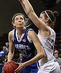 SIOUX FALLS MARCH 22:  Tess Bruffey #54 of Lubbock Christian drives on Anja Fuchs-Robetin#24 of Florida Southern College during their quarterfinal game at the NCAA Women's Division II Elite 8 Tournament at the Sanford Pentagon in Sioux Falls, S.D. (Photo by Dick Carlson/Inertia)