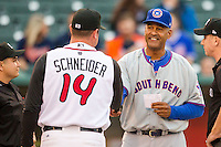 South Bend Cubs manager Jimmy Gonzalez (44) shakes hands with Lansing Lugnuts manager John Schneider (14) before the game on May 12, 2016 at Cooley Law School Stadium in Lansing, Michigan. Lansing defeated South Bend 5-0. (Andrew Woolley/Four Seam Images)
