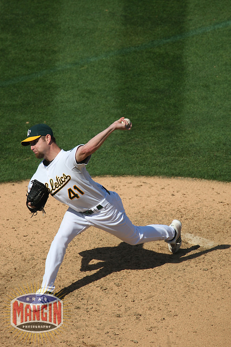 OAKLAND, CA - SEPTEMBER 14:  Alan Embree of the Oakland Athletics pitches during the game against the Texas Rangers at the McAfee Coliseum in Oakland, California on September 14, 2008.  The Athletics defeated the Rangers 7-4.  Photo by Brad Mangin