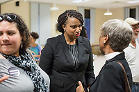 Ayanna Pressley (center) greets people after speaking at an event put on by Chelsea Black Community at the Chelsea Senior Center in Chelsea, Massachusetts, USA, on Wed., June 27, 2018. Pressley is running in the Democratic primary Massachusetts 7th Congressional District against incumbent Mike Capuano. Pressley is currently serving as a member of the Boston City Council, and is the first woman of color elected to the Council.