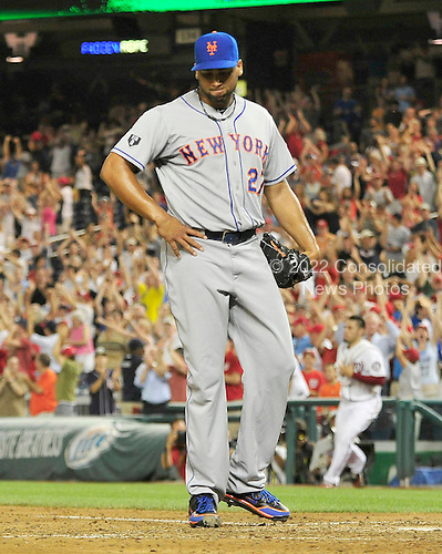 New York Mets pitcher Pedro Beato (27) looks to the ground after uncorking a wild pitch that allowed the Washington Nationals to score the winning run in the 10th inning at Nationals Park in Washington, D.C. on Tuesday, July 17, 2012.  The Nationals won in 10 innings 5 - 4..Credit: Ron Sachs / CNP.(RESTRICTION: NO New York or New Jersey Newspapers or newspapers within a 75 mile radius of New York City)