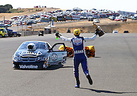 Jul. 28, 2013; Sonoma, CA, USA: NHRA pro stock motorcycle rider Hector Arana Jr runs to celebrate with pro stock winner Vincent Nobile after winning the Sonoma Nationals at Sonoma Raceway. Mandatory Credit: Mark J. Rebilas-