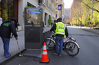 New York City Department of Transportation set up one of 6000 BikeShare stations on Washington Square East