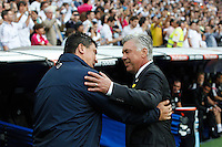 Carlo Anceloti of Real Madrid and German Burgos of Atletico de Madrid during La Liga match between Real Madrid and Atletico de Madrid at Santiago Bernabeu stadium in Madrid, Spain. September 13, 2014. (ALTERPHOTOS/Caro Marin)
