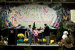 November 15, 2008. Fayetteville, NC..One thousand Army wives and active duty soldiers pregnant with what the locals call ?surge babies? were celebrated at the biggest military baby shower ever. These babies were conceived when.troops from the 82nd Airborne Division, deployed to Iraq for the surge of forces in January 2007, began returning home to Fort Bragg in November.. (left to right) Sarah Deady, Fray Natalie and Valerie Ureste all had children in the last 96 hours before the shower.