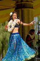 A hula dancer performs at Kapiolani park bandstand on May day, also known in Hawaii as lei day