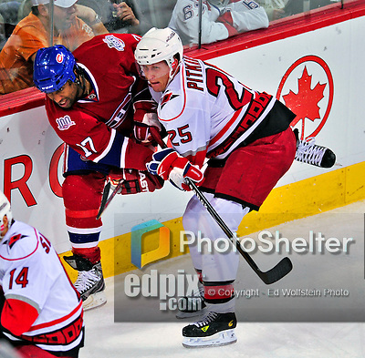 21 December 2008: Montreal Canadiens' right wing forward Georges Laraque is checked along the boards by Carolina Hurricanes' defenseman Joni Pitkanen from Finland in the second period at the Bell Centre in Montreal, Quebec, Canada. The Hurricanes defeated the Canadiens 3-2 in overtime. ***** Editorial Sales Only ***** Mandatory Photo Credit: Ed Wolfstein Photo