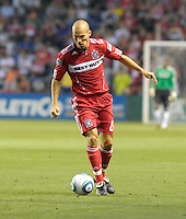 Chicago midfielder Freddie Ljungberg (8) dribbles the ball.  The Chicago Fire tied the New York Red Bulls 0-0 at Toyota Park in Bridgeview, IL on August 8, 2010
