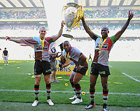 Aviva Premiership Final .Twickenham, England. Mike Brown, Jordan Turner-Hall, Ugo Monye of Harlequins celebrates with the trophy following his team's victory during the Aviva Premiership final between Harlequins and Leicester Tigers at Twickenham Stadium on May 26, 2012 in London, England.