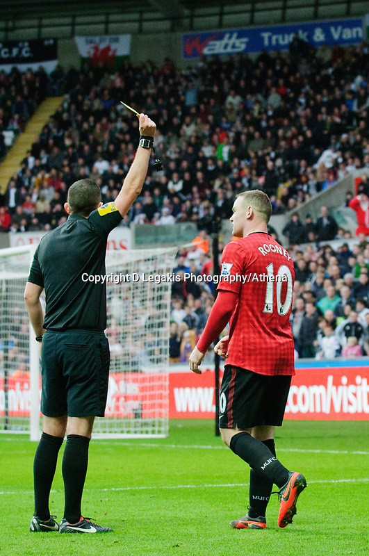 Sunday, 23 November 2012<br /> <br /> Pictured: Wayne Rooney of Manchester United gets a yellow card<br /> <br /> Re: Barclays Premier League, Swansea City FC v Manchester United at the Liberty Stadium, south Wales.