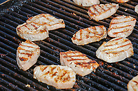 Pork loins lay on a grill at the Iowa Pork Producers Association Pork Tent at the Iowa State Fair in Des Moines, Iowa, on Tues., Aug. 13, 2019.