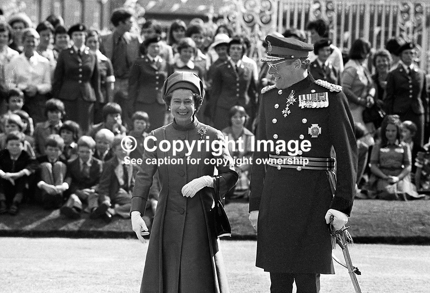 Queen Elizabeth II, in the grounds of Government House, Hillsborough, Co Down, during her Silver Jubilee visit to N Ireland. She is accompanied General Sir John d'Arcy Anderson, Colonel Commandant, Ulster Defence Regiment. 197708100074a<br /> <br /> Copyright Image from Victor Patterson,<br /> 54 Dorchester Park, <br /> Belfast, UK, BT9 6RJ<br /> <br /> t1: +44 28 9066 1296 (from Rep of Ireland 048 9066 1296)<br /> t2: +44 28 9002 2446 (from Rep of Ireland 048 9002 2446)<br /> <br /> m: +44 7802 353836<br /> <br /> e: victorpatterson@me.com<br /> www.victorpatterson.com<br /> <br /> Please see my Terms and Conditions of Use at www.victorpatterson.com. It is IMPORTANT that you familiarise yourself with them.<br /> <br /> Images used on the Internet must be visibly watermarked i.e. &copy; Victor Patterson<br /> within the body of the image and copyright metadata must not be deleted. Images <br /> used on the Internet have a size restriction of 4kbs and will be chargeable at current<br />  NUJ rates unless agreed otherwise.<br /> <br /> This image is only available for the use of the download recipient i.e. television station, newspaper, magazine, book publisher, etc, and must not be passed on to any third <br /> party. It is also downloaded on condition that each and every usage is notified within 7 days to victorpatterson@me.com<br /> <br /> The right of Victor Patterson to be identified as the author is asserted in accordance with The Copyright Designs And Patents Act (1988). All moral rights are asserted.